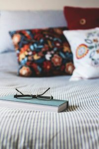 pillows and book on bed