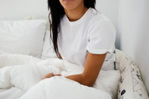 lady sitting up in bed